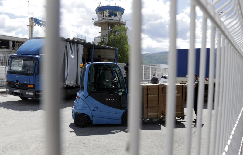 Civil protection workers move boxes of ventilators at the customs post in the Bosnia capital Sarajevo, Thursday, April 30, 2020.  In their initial report, the Bosnian state prosecutors said in a statement released Monday May 11, 2020, that the ventilators imported from China by private company Silver Raspberry, and paid for by the country's government, have been found to be useless for COVID-19 coronavirus patients.  (AP Photo)