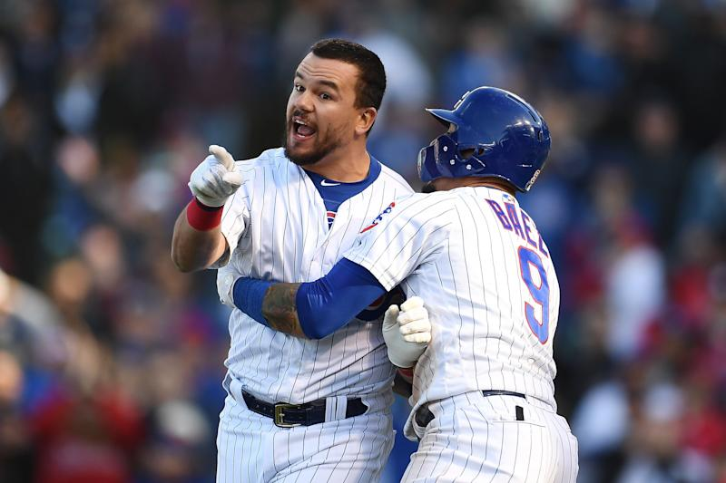 Kyle Schwarber is retained by his teammate Cubs Javier Baez after a doubtful call to end Saturday's loss against the Angels. (Photo by Stacy Revere / Getty Images)