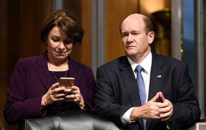 Senate Judiciary Committee members Amy Klobuchar (D-MN) (L) and Christopher Coons (D-DE) look on after a markup hearing on Capitol Hill in Washington, DC on September 28, 2018, on the nomination of Brett M. Kavanaugh to be an associate justice of the Supreme Court of the United States. - Kavanaugh's contentious Supreme Court nomination will be put to an initial vote Friday, the day after a dramatic Senate hearing saw the judge furiously fight back against sexual assault allegations recounted in harrowing detail by his accuser. (Photo by Brendan SMIALOWSKI / AFP) (Photo credit should read BRENDAN SMIALOWSKI/AFP/Getty Images)