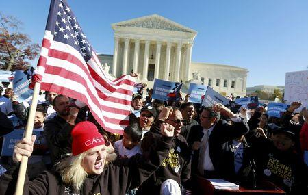 Immigrants and community leaders rally in front of the U.S. Supreme Court to mark the one-year anniversary of President Barack Obama's executive orders on immigration in Washington, in this file photo taken November 20, 2015. REUTERS/Kevin Lamarque/Files