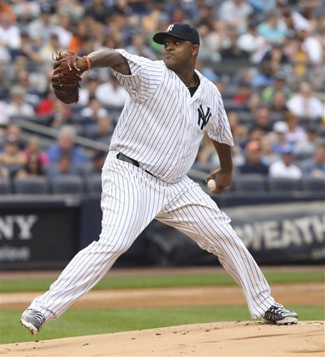 New York Yankees' CC Sabathia pitches during the first inning of the baseball game against the Boston Red Sox at Yankee Stadium in New York, Saturday, July 28, 2012. (AP Photo/Seth Wenig)