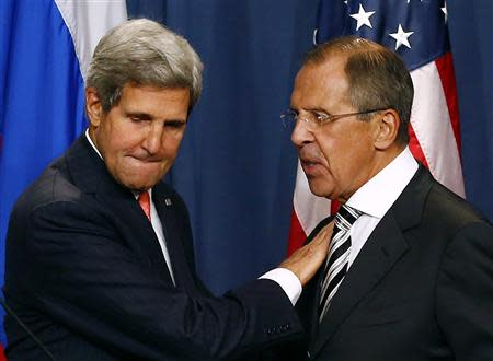 U.S. Secretary of State John Kerry (L) and Russian Foreign Minister Sergei Lavrov shake hands after making statements following meetings regarding Syria, at a news conference in Geneva in this September 14, 2013 file picture. REUTERS/Ruben Sprich