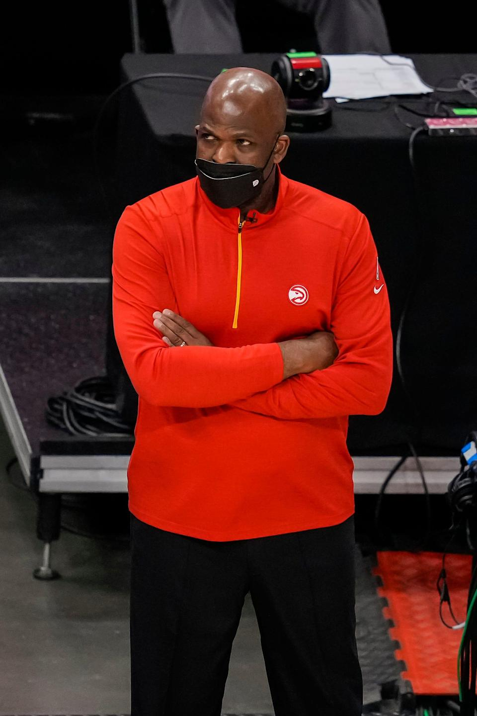 Atlanta Hawks interim head coach Nate McMillan watches the action from the bench against the Washington Wizards during the second half at State Farm Arena.
