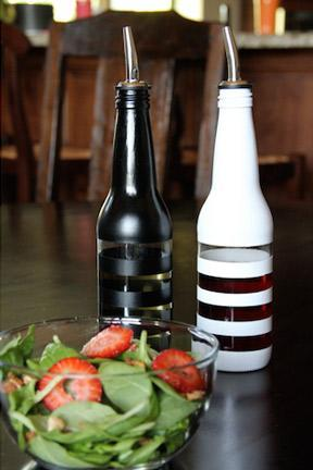 """<div class=""""caption-credit""""> Photo by: Ardor</div><div class=""""caption-title"""">Soda Bottle Oil Dispensers</div>Have a stash of old soda or beer bottles? Clean them up, and paint them with stripes to make custom oil and vinegar dispensers! <br> <a href=""""http://www.babble.com/crafts-activities/upcycled-10-crafts-that-you-can-make-from-trash-and-turn-into-treasure/?cmp=ELP bbl lp YahooShine Main  031313  Upcycled10CraftsThatYouCanMakeFromTrashAndTurnIntoTreasure famE   """" rel=""""nofollow noopener"""" target=""""_blank"""" data-ylk=""""slk:Get the tutorial at Ardor"""" class=""""link rapid-noclick-resp""""><i>Get the tutorial at Ardor</i></a>"""