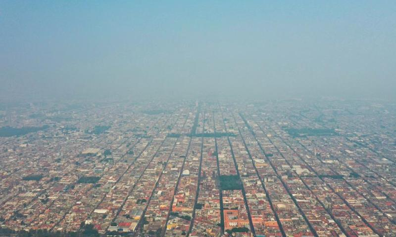 A thick layer of smog envelops the city of Puebla, southeast of Mexico City