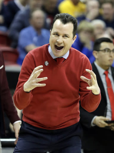New Mexico head coach Paul Weir instructs his team during the first half of an NCAA college basketball game against Wyoming in the Mountain West Conference tournament, Wednesday, March 13, 2019, in Las Vegas. (AP Photo/Isaac Brekken)