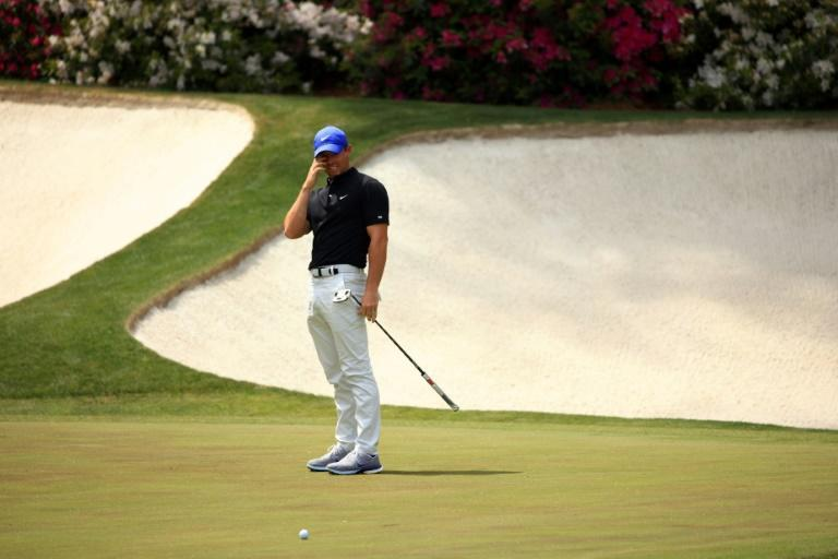 Northern Ireland's Rory McIlroy reacts after missing a putt on the 13th green in the first round of the Masters