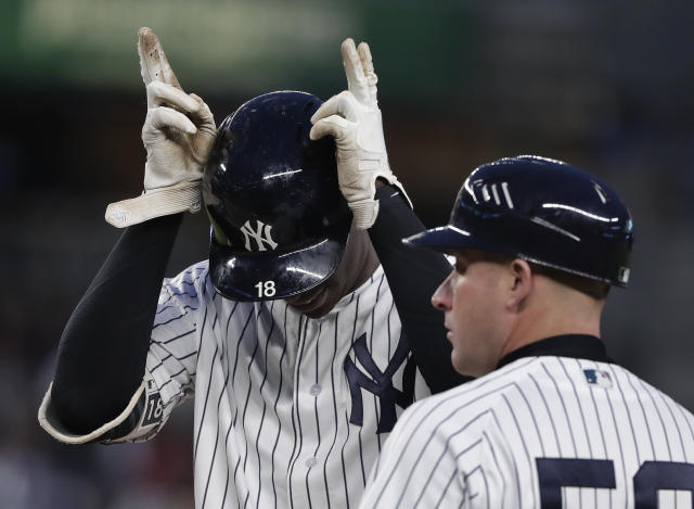 New York Yankees' Didi Gregorius (18) motions to the dugout after driving in a run with a base hit to left field against the Minnesota Twins during the third inning of a baseball game Tuesday, April 24, 2018, in New York. (AP Photo/Julie Jacobson)