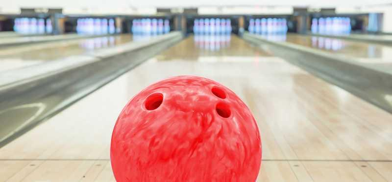 A bowling ball on a lane.
