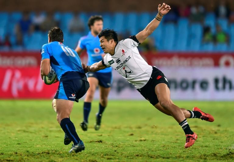 Handre Pollard (L) of the Blue Bulls is tackled by Shota Emi (R) of the Sunwolves during their Super XV rugby union match against the Sunwolves at Loftus Versfeld Stadium on March 17, 2017 in Pretoria, South Africa