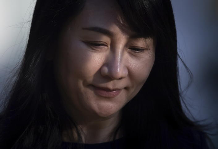 Meng Wanzhou, the chief financial officer of Huawei, leaves her home to attend a hearing at British Columbia Supreme Court, in Vancouver, British Columbia, on Monday, March 15, 2021. (Darryl Dyck/The Canadian Press via AP)