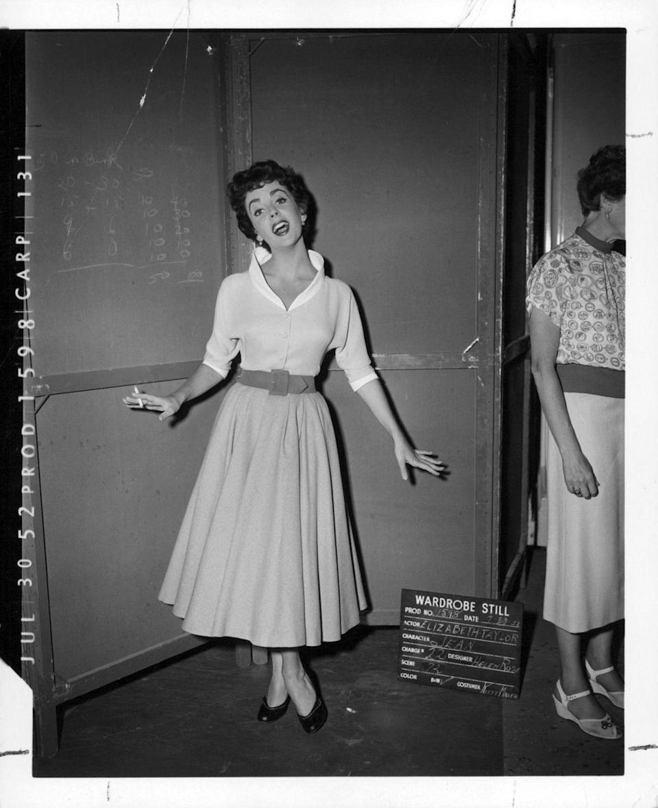 <p>Taylor is photographed during a photo shoot with wardrobe while on set for <em>The Girl Who Had Everything</em><em>, </em>her 17th film, which premiered in 1953. </p>