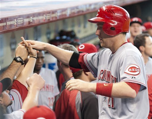 Cincinnati Reds' Todd Frazier is congratulated by teammates after scoring on a double by Chris Heisey during the eighth inning of a baseball game against the Houston Astros, Sunday, Sept. 2, 2012, in Houston. (AP Photo/Dave Einsel)