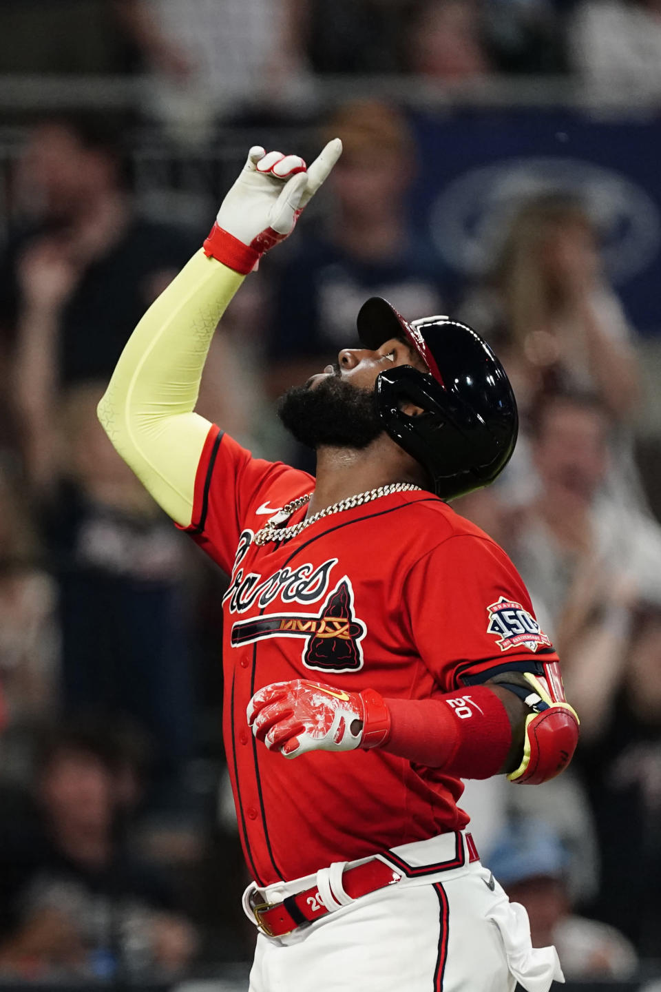 Atlanta Braves' Marcell Ozuna gestures after hitting a solo home run during the sixth inning of the team's baseball game against the Pittsburgh Pirates on Friday, May 21, 2021, in Atlanta. (AP Photo/John Bazemore)