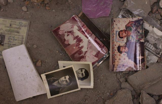 Photos left behind in the Old City of Mosul, at a house occupied by ISIS, perhaps dropped in a moment of desperation. (Photos: Ash Gallagher for Yahoo News)