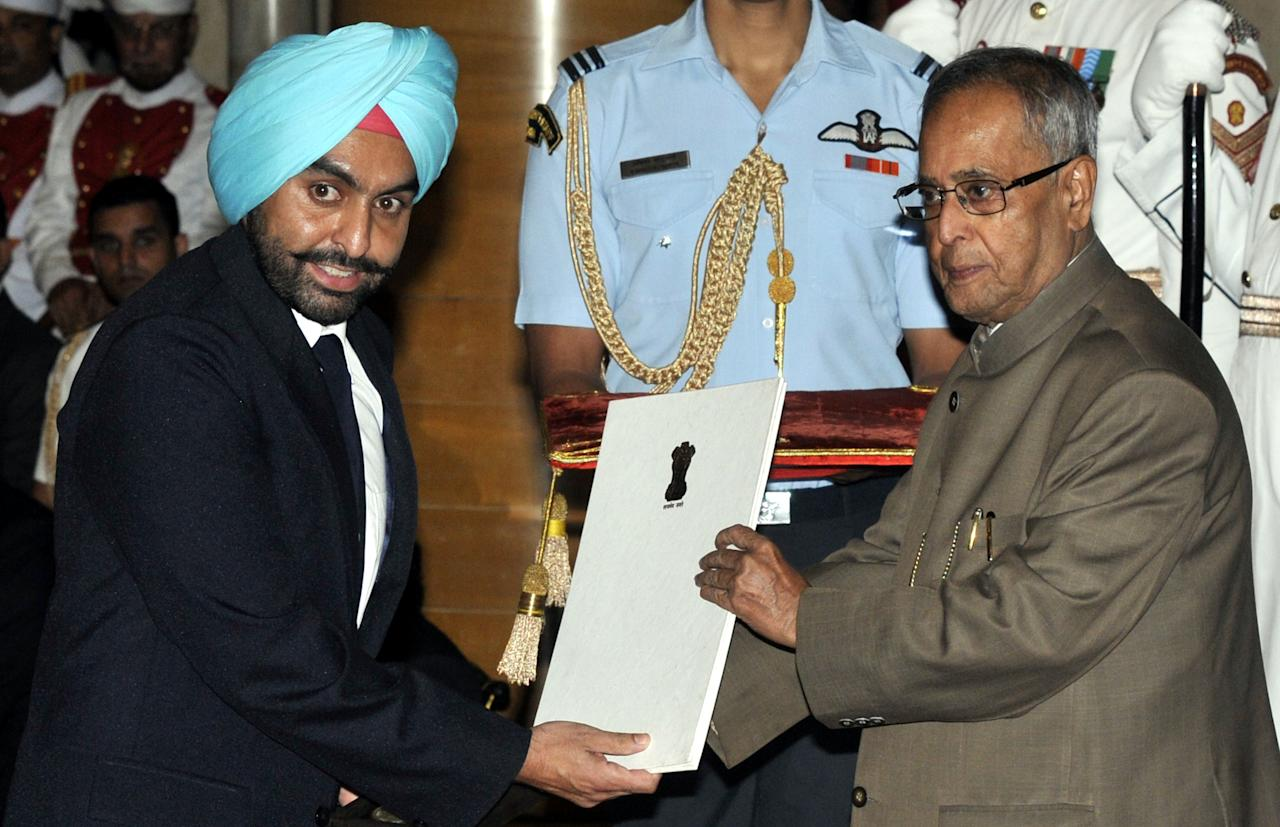 NEW DELHI, INDIA - AUGUST 31: President Pranab Mukherjee honors shooter Ronjan Sodhi with Rajiv Gandhi Khel Ratna  during National Sports Award presentation ceremony at Rashtrapati Bhavan on August 31, 2013 in New Delhi, India. National Sports Awards were presented to the country's top athletes and coaches with shooter Ronjan Sodhi getting the country's highest sporting honour Rajiv Gandhi Khel Ratna, while cricketer Virat Kohli was among the Arjuna awardees. (Photo by Mohd Zakir/Hindustan Times via Getty Images)