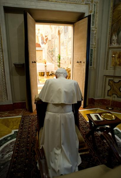 "In this photo provided by the Vatican newspaper L'Osservatore Romano, Pope Benedict XVI kneels in prayer at the end of a weeklong spiritual retreat, at the Vatican, Saturday, Feb. 23, 2013. Benedict XVI has lamented the ""evil, suffering and corruption"" that has defaced God's creation in a final address to the officials who run the Vatican bureaucracy. Benedict spoke off-the-cuff Saturday at the end of a weeklong spiritual retreat coinciding with the Catholic Church's solemn Lenten season. For the past week, Italian Cardinal Gianfranco Ravasi has led the Vatican on meditations that have covered everything from the family to denouncing the ""divisions, dissent, careerism, jealousies"" that afflict the Vatican bureaucracy. (AP Photo/L'Osservatore Romano, ho)"