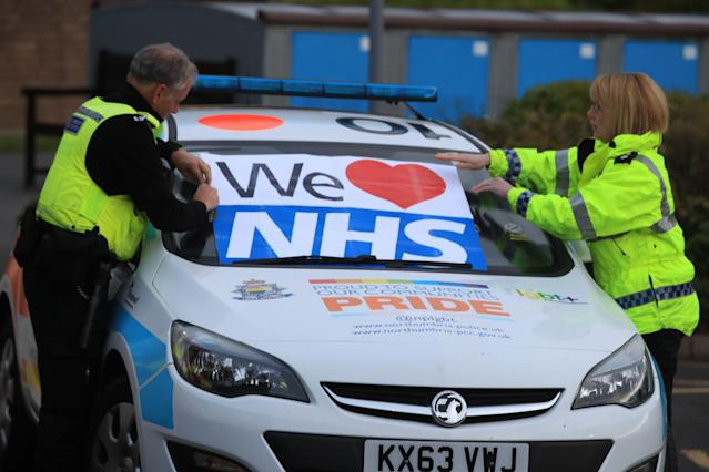 Staff put a sign on the windshield in support of the NHS at the Freeman Hospital in Newcastle upon Tyne, to salute local heroes during Thursday's nationwide Clap for Carers initiative to recognise and support NHS workers fighting the coronavirus pandemic.