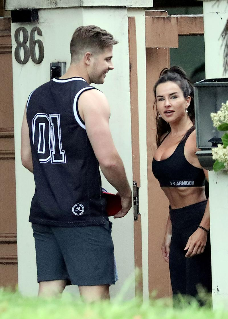 Married At First Sight star Michael 'Mikey' Pembroke with a mystery brunette outside a Vaucluse gym