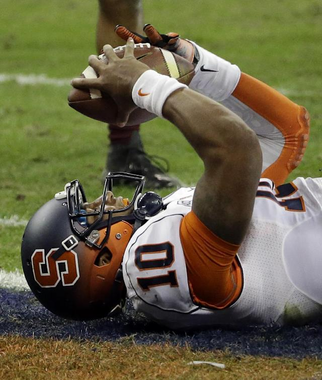 Syracuse quarterback Terrel Hunt (10) holds up the ball as he celebrates his rushing touchdown during the third quarter of the Texas Bowl NCAA college football game against Minnesota, Friday, Dec. 27, 2013, in Houston. Syracuse won 21-17. (AP Photo/David J. Phillip)