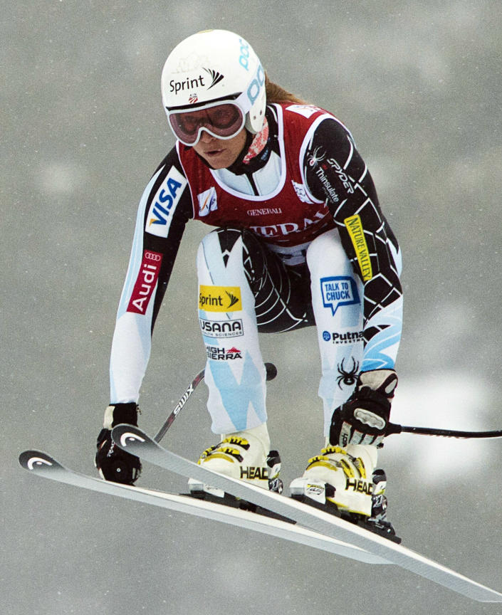Julia Mancuso of the United States, speeds down the course at the women's World Cup downhill ski race in Lake Louise, Alberta, Friday, Nov. 30, 2012. (AP Photo/The Canadian Press, Jonathan Hayward)