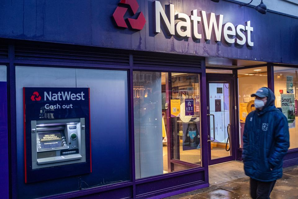 LONDON, UNITED KINGDOM - 2021/01/15: A man wearing a facemask as a preventive measure against the Covid-19 coronavirus walks past a branch of NatWest Bank in London. (Photo by May James/SOPA Images/LightRocket via Getty Images)