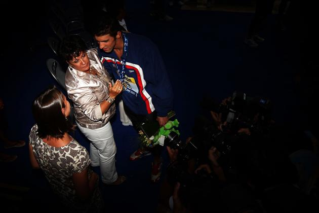 ROME - AUGUST 02:  Michael Phelps of the United States celebrates with his mother Debbie and sister Hillary after victory in the Men's 4x 100m Medley Relay Final during the 13th FINA World Championships at the Stadio del Nuoto on August 2, 2009 in Rome, Italy.  (Photo by Lars Baron/Bongarts/Getty Images) *** Local Caption *** Michael Phelps;Debbie Phelps;Hillary Phelps