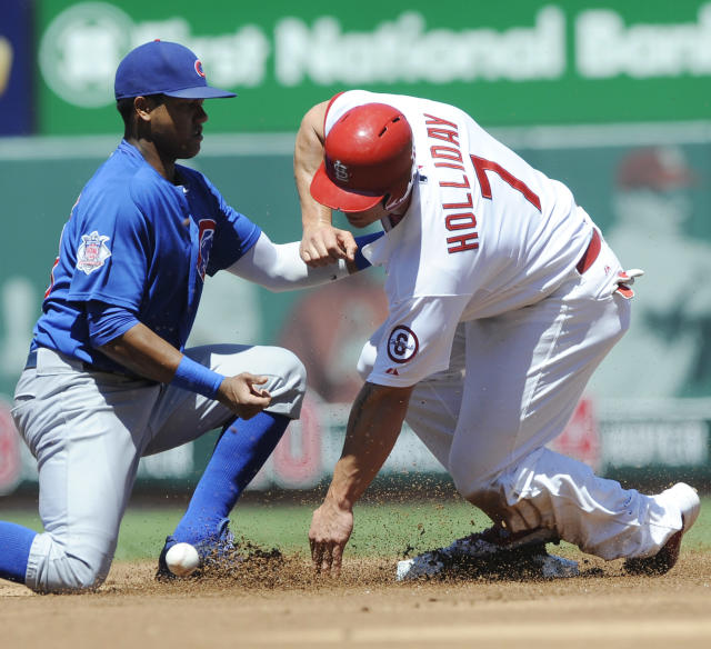 St. Louis Cardinals' Matt Holliday (7) steals second as Chicago Cubs' Starlin Castro, left, cannot make the tag in the first inning in a baseball game on Sunday, Aug. 11, 2013, at Busch Stadium in St. Louis. (AP Photo/Bill Boyce)