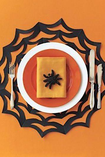 """<p>Serve up Halloween-themed dishes in style with the help of this spiderweb placemat craft.</p><p><strong><em><a href=""""https://www.womansday.com/home/crafts-projects/how-to/a5903/halloween-craft-how-to-spiderweb-placemat-123822/"""" rel=""""nofollow noopener"""" target=""""_blank"""" data-ylk=""""slk:Get the Spiderweb Placemat tutorial"""" class=""""link rapid-noclick-resp"""">Get the Spiderweb Placemat tutorial</a>.</em></strong></p><p><a class=""""link rapid-noclick-resp"""" href=""""https://www.amazon.com/Colorbok-74293-12x12in-Smooth-Cardstock/dp/B07GVRW1L2?tag=syn-yahoo-20&ascsubtag=%5Bartid%7C10070.g.1908%5Bsrc%7Cyahoo-us"""" rel=""""nofollow noopener"""" target=""""_blank"""" data-ylk=""""slk:SHOP BLACK CONSTRUCTION PAPER"""">SHOP BLACK CONSTRUCTION PAPER</a></p>"""