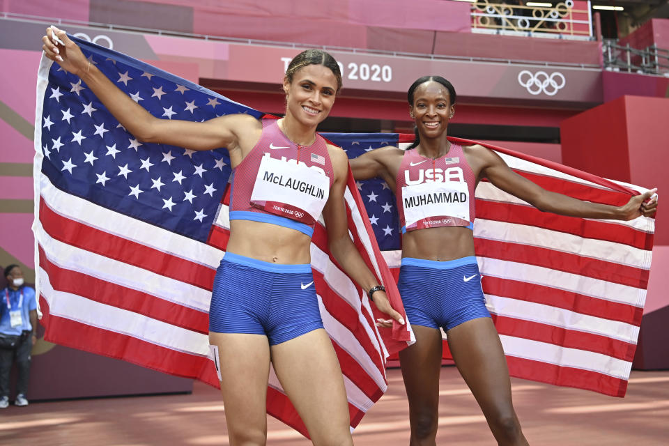 Sydney Mclaughlin, left, and Dalilah Muhammad, both of the United States, celebrate after finishing first and second respectively in the women's 400m hurdles final during the 2020 Summer Olympics on Wednesday, Aug. 4, 2021, in Tokyo, Japan . (Andrej ISAKOVIC / POOL / AFP)