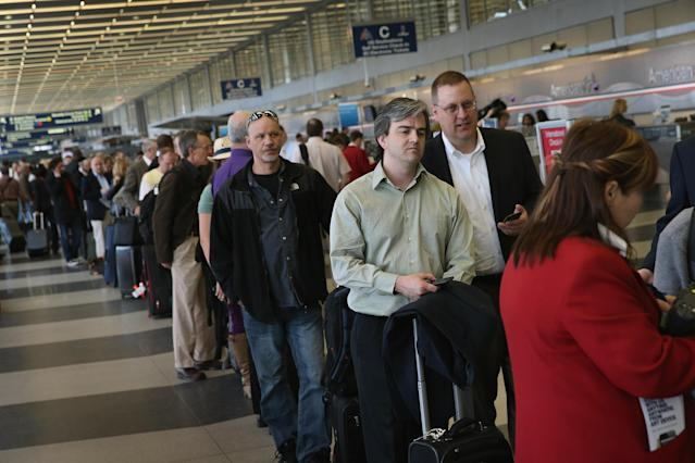 CHICAGO, IL - APRIL 16: American Airlines passengers wait in line to reschedule flights at O'Hare Airport on April 16, 2013 in Chicago, Illinois. Thousands of American Airlines travelers became stranded today when the airline was forced to ground all its flights after a nationwide problem with its computer systems. (Photo by Scott Olson/Getty Images)