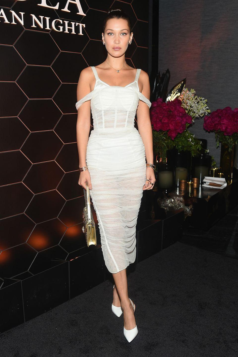 <p>In a sheer dress with white pumps at the Bulgari fragrance launch event in NYC.</p>