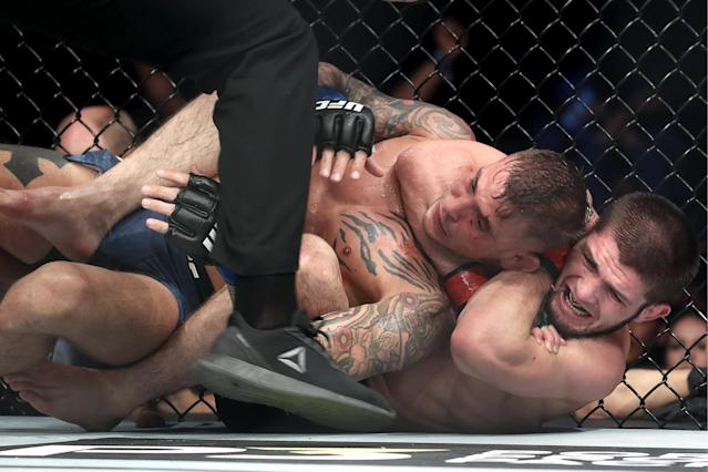 UFC lightweight champion Khabib Nurmagomedov submits Dustin Poirier at UFC 242. (Getty Images)