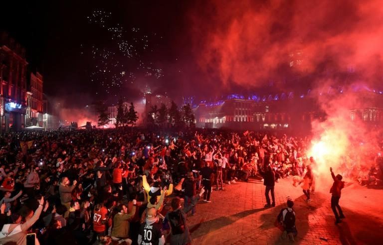 Lille's supporters celebrate after winning the French Ligue 1 title