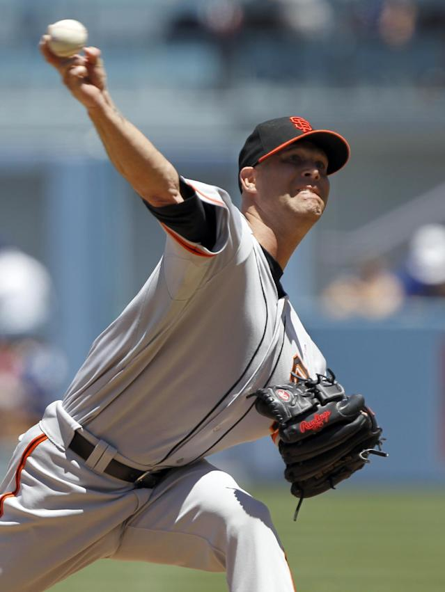 San Francisco Giants starting pitcher Tim Hudson throws against the Los Angeles Dodgers in the first inning of a baseball game on Sunday, May 11, 2014, in Los Angeles. (AP Photo/Alex Gallardo)