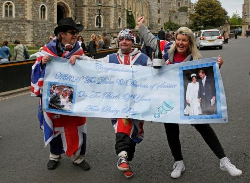 Fans gathered near Windsor Castle to welcome the new royal baby