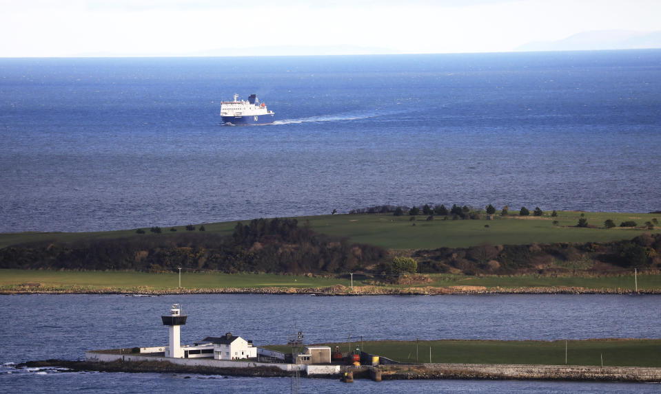 A P&O ferry from Scotland crosses the Irish Sea making way towards the port at Larne on the north coast of Northern Ireland, Friday, Jan. 1, 2021. This New Year's Day is the first day after Britain's Brexit split with the European bloc's vast single market for people, goods and services, and the split is predicted to impact the Northern Ireland border. (AP Photo/Peter Morrison)