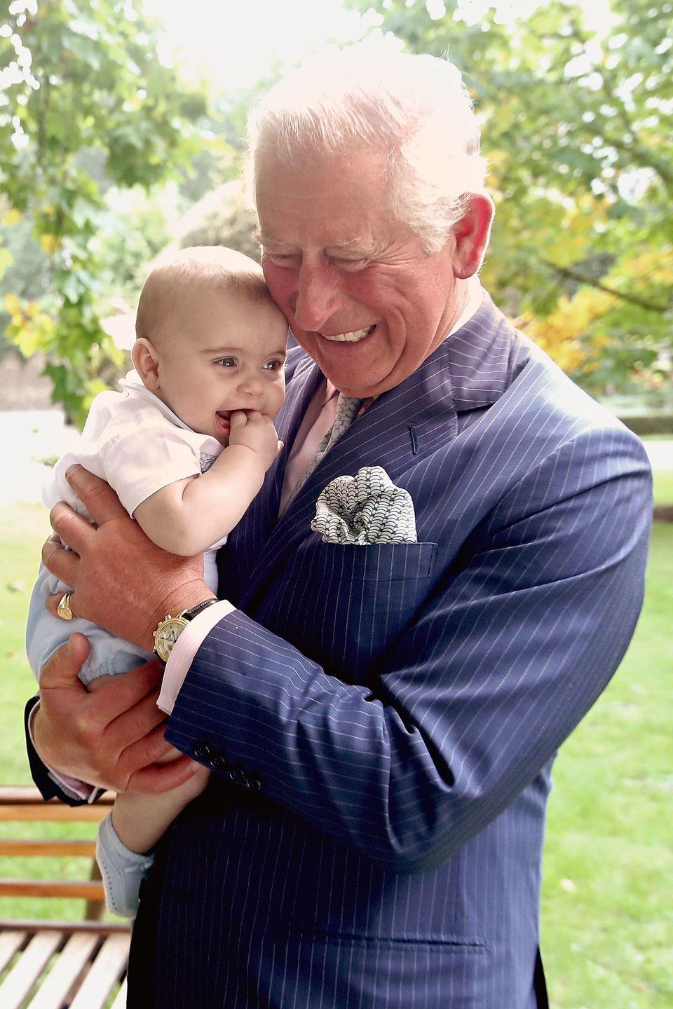 <p>Prince Louis giggles in a solo portrait with his grandpa. </p>