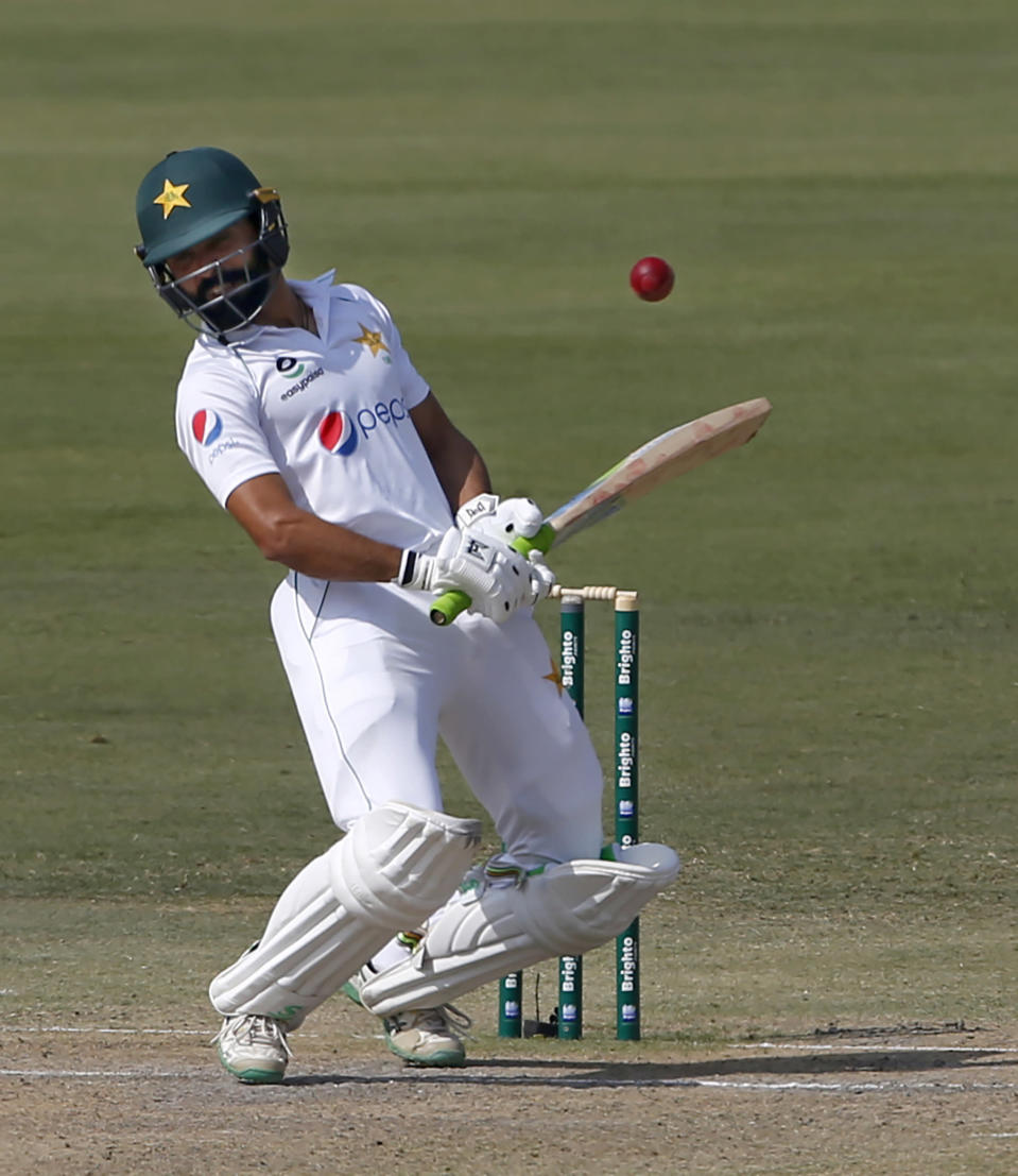 Pakistan's batsman Fawad Alam avoids to play a ball during the second day of the first cricket test match between Pakistan and South Africa at the National Stadium, in Karachi, Pakistan, Wednesday, Jan. 27, 2021. (AP Photo/Anjum Naveed)