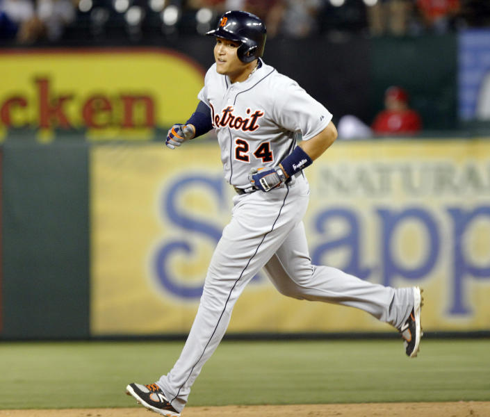 Detroit Tigers Miguel Cabrera rounds the bases, after hitting his second home run of the game, in the fifth inning of a baseball game against the Texas Rangers Sunday, May 19, 2013, in Arlington.  (AP Photo/John F. Rhodes)