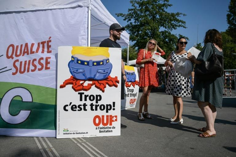 """The anti-immigration Swiss People's Party rolled out a campaign poster with the slogan: """"Enough is enough!"""""""