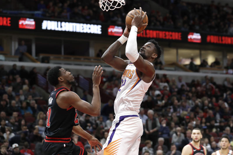 Phoenix Suns center Deandre Ayton shoots against Chicago Bulls forward Thaddeus Young during the second half of an NBA basketball game in Chicago, Saturday, Feb. 22, 2020. The Suns won 112-104. (AP Photo/Nam Y. Huh)