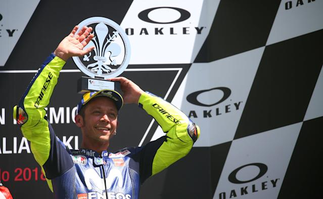 Motorcycling - MotoGP - Italian Grand Prix - Mugello Circuit, Scarperia, Italy - June 3, 2018 Yamaha MotoGP's Valentino Rossi (R) celebrates finishing in third place with the trophy on the podium REUTERS/Alessandro Bianchi