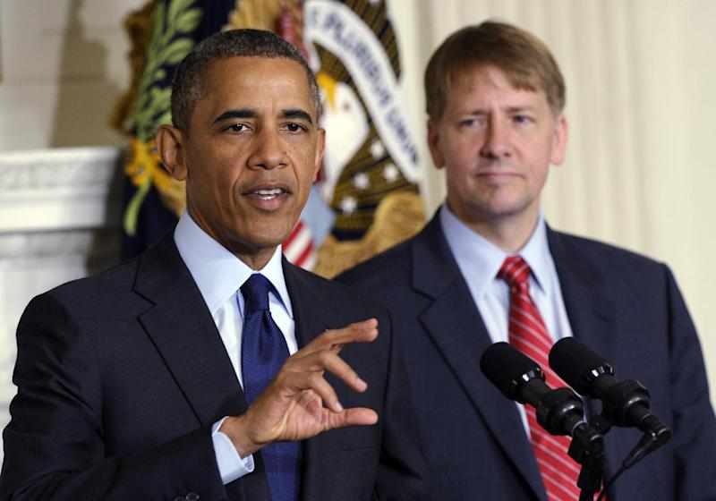 President Barack Obama, left, speaks as he stands with Richard Cordray, right, the new director of the Consumer Financial Protection Bureau, during a statement in the State Dining Room of the White House in Washington, Wednesday, July 17, 2013. The Senate voted on Tuesday, July 16, 2013, to end a two-year Republican blockade that was preventing Cordray from winning confirmation as director of the Consumer Financial Protection Bureau. (AP Photo/Susan Walsh)