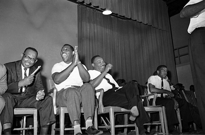 <p>Dr. Martin Luther King Jr. right, and Charles Evers, Miss. NAACP field secretary, enjoy laugh during fund raising time at mass rally in Jackson, Mississippi on July 22, 1964. (AP Photo/Jim Bourdier) </p>
