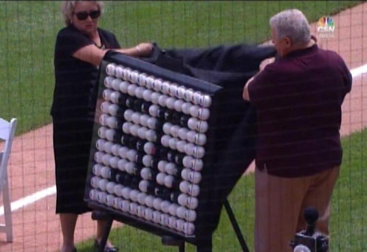 Mark Buehrle is presented with a cool piece of art put together by Ron Kittle. (Comcast SportsNet Chicago)
