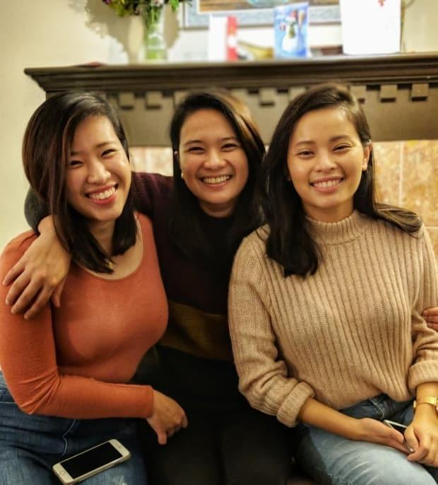 Anne Ignacio (centre) and her two sisters. Anne said she started studying kinesiology after being unable to pass the IELTS, one of the requirements for working as a registered nurse in B.C. (Anne Ignacio/Submitted - image credit)