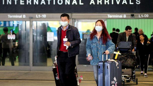PHOTO: Passengers leave LAX after arriving from Shanghai, China, after a positive case of the coronavirus was announced in the Orange County suburb of Los Angeles, Jan. 26, 2020. (Ringo Chiu/Reuters)