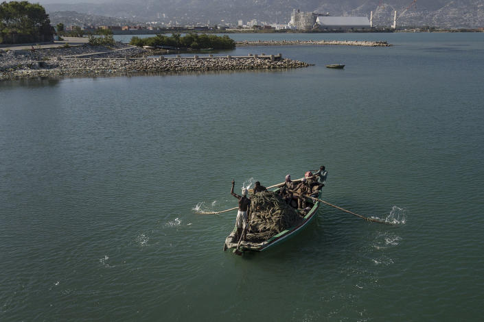 Fishermen return to the shore near the La Saline neighborhood of Port-au-Prince, Haiti, Monday, July 19, 2021. The country of more than 11 million people are still reeling from the July 7 killing of President Jovenel Moise. (AP Photo/Matias Delacroix)