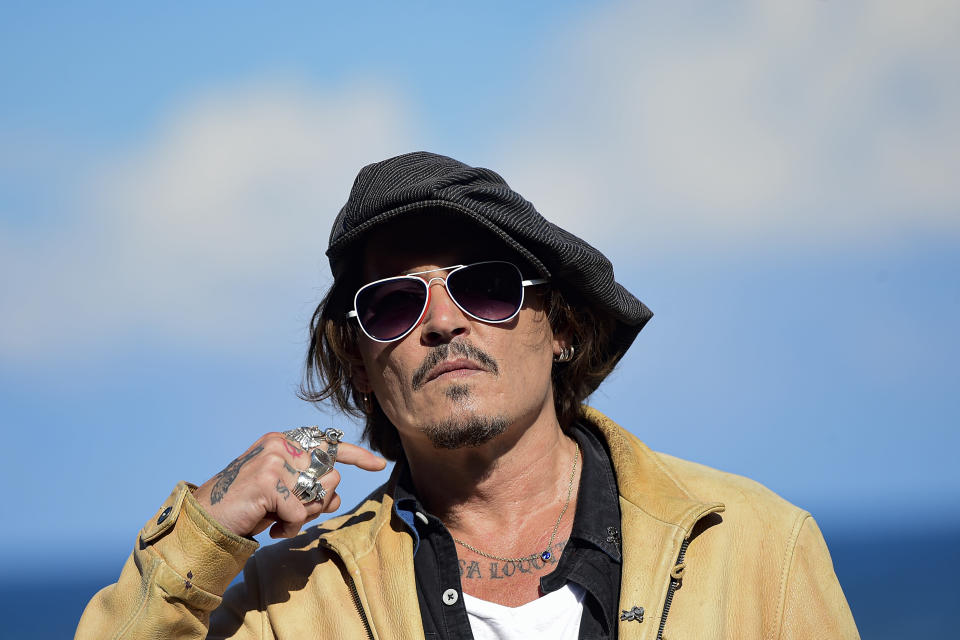 "FILE - In this file photo dated Sunday, Sept. 20, 2020, US actor and film producer Johnny Deep during the photocall for his film ""Crock of Gold: A Few Rounds with Shane Macgoman"" at the 68th San Sebastian Film Festival, in San Sebastian, northern Spain. Britain's judicial office said Tuesday Oct. 27, 2020, that judge Andrew Nicol will deliver his verdict in writing on Nov. 2, ruling on whether Johnny Depp was libelled by a tabloid newspaper that branded him a wife-beater. (AP Photo/Alvaro Barrientos, FILE)"